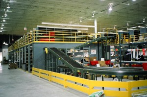 17' high shelving catwalk with conveyor